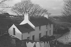 A ghost disturbs Pete and Sian Allport after moving to Garreg Wen near Porthmadog, home of the harpist Dafydd y Garreg Wen (1556991) (LlGC ~ NLW) Tags: cymru wales llyfrgellgenedlaetholcymru nationallibraryofwales charlesgeoff19092002 negyddffilm filmnegatives hauntedhouse dafyddygarregwen ghost fright fear haunted