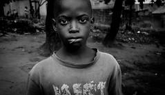 Katwe V (gunnisal) Tags: africa portrait boy face child kampala katwe uganda bw blackandwhite monochrome gunnisal