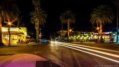 Embarcadero - Isla Vista (AlphaPhoenix) Tags: islavista lighttrails streetphotography habitburger freebirds subway starbucks car headlights road bike intersection city california