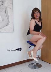 Light gray miniskirt, black sleeveless shirt, white high heels. (Elsa Adriana) Tags: elsaadriana highheels white crossdresser tgirl travesti transvestite miniskirt mature