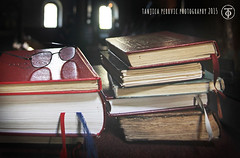 More Books.. (Tanjica Perovic Photography) Tags: windows lowlight serbia books srbija easternorthodox readingglasses antiquebooks churchinterior bookmarkers stacksofbooks  pevnica pirotserbia nativitychurchpirotserbia   glassesonbooks