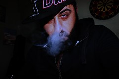 Smoke. (cambazghettostar34) Tags: chicago underground beard eyes guitar good brother cigarette smoke trkiye beards istanbul bulls cap hiphop rapper gangsta dart sakal sigara duman