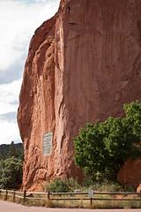 Signature Rock (gljorgen) Tags: summer orange usa tree rock clouds plaque season landscape colorado rocks hiking gardenofthegods rough