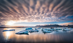 15 Seconds at Jökulsárlón (explored) (hpd-fotografy) Tags: arctic flowing goldencircle iceland jokulsarlon nikon nordic pure sandinavia scenic clouds dramatic glacier iceberg lagoon longexposure mood nature outdoors panorama seascape sky sunset travel ultrawide water is ~themagicofcolours~vi