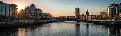 Cityscape at sunset - Dublin, Ireland - Cityscape photography (Giuseppe Milo (www.pixael.com)) Tags: color calm print reflection orange outside photography sky wallart fineart canvas prints sunset ireland skyline european depth architecture gold quays view liffey clouds photo sun urban photograph tranquil cityscape travel water bridges dublin colors horizontal river europe brigde yellow onsale
