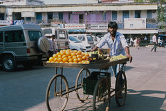 Mobile Street Vendor (AnniversaryRoad) Tags: 135 35mm 50mm fujiprovia india indian karnataka leica leicam6 summicron udupi analog cars color colour film fruit fuji market merchant outdoor outdoors outside positive positivefilm provia reversalfilm seller slide slidefilm street streetphotography vehicles wheels