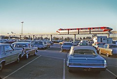 Disneyland Monorail passing the parking lot, January 1967 (Tom Simpson) Tags: vintage disney disneyland vintagedisney vintagedisneyland 1960s monorail disneylandmonorail disneylandalwegmonorail redmonorail red monorailred 1967