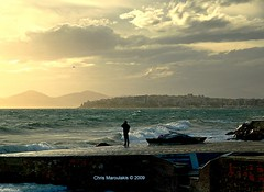 The call (Chris Maroulakis) Tags: athens faliron man call south winds sunset sea nikon d50 chris maroulakis 2009