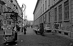 """Leaflets To The Wind"" (giannipaoloziliani) Tags: leaflets turin downtown torino city italia italy centre blackandwhite monocromo monochrome biancoenero centro citt strada banchi architectures sky skyline piemonte market street urbanstreet urban urbanblackandwhite mercatino people lamps graffiti windows palaces architettura palazzi finestre cielo volantini streetlife citylife nikoncamera nikon nikond3200 flyers paper carta urbanlife horizon lampioni"