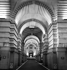 """Coming out of the Tunnel.... I am bursting with a new found feeling of my own existence. Strong and powerful frequencies. My mind is wandering to wide open fields and long-forgotten lands  with limitless possibilities.  I am not quite there yet. Holding (venesha83) Tags: countyhall london arch blackandwhite mono shadows marriott"