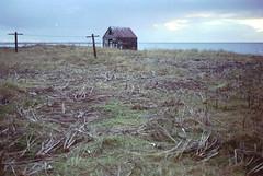 une friche (asketoner) Tags: house abandoned sea landscape grass blue daylight cloud ocean iceland wood cross