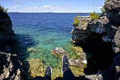 Grotto Chillin (xvr.ayala) Tags: blue sky cliff ontario feet nature water clouds bay high rocks aqua legs bruce georgianbay diving yours grotto georgian cave adidas peninsula brucepeninsula tobermory clearwater discover
