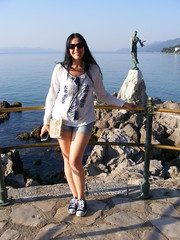 Water Babe - Nina in Opatija (seanfderry-studenna) Tags: street sea summer woman sun white public water girl beautiful beauty smile face sunglasses smiling statue mobile female pose dark hair happy coast seaside shoes girlfriend rocks long phone married legs path top gorgeous posing trainers jeans stunning wife denim shorts nina handbag pathway opatija adriatic fiancee 2015