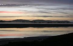 Sun setting over the River Nith at Glencaple (penlea1954) Tags: uk sunset sea sun mist fog set river evening scotland setting dumfries galloway harr nith glencaple