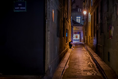 You're never alone with a phone (Mike Franks) Tags: paris france mobile night dark alley streetlight marais 1635mm
