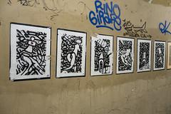 Street Art - Florence - II (UrbanphotoZ) Tags: blackandwhite italy streetart abstract wall airplane graffiti florence heart wheatpaste tags urbanart torn firenze figures cubist