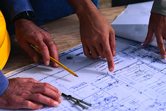 CB026167 (Donna and Ed Edwards) Tags: 2 people men architecture photography hands colorphotography gesturing planning males whites architects pointing adults blueprints constructionsites occupationsandwork buildingplans