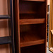 Dark wood stained tiered magazine rack