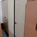 Tall two door units metal/ comes with shelves