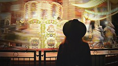 Taken away to the dark side (Hey, Nuclear Winter! ) Tags: city game london girl hat kids night lights dynamic carousel move exposition carrousel