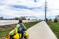 Cycling alongside the busy E-470 highway in Denver, CO.
