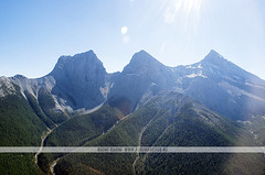 Three Sisters - Banff National Park, Canada (Naomi Rahim (thanks for 2 million hits)) Tags: park travel summer canada mountains rock forest landscape nikon flight aerial wanderlust helicopter alpine alberta threesisters pacificnorthwest banff rockymountains canmore pnw birdseyeview banffnationalpark canadianrockies 2015 travelphotography nikond7000 naomirahim