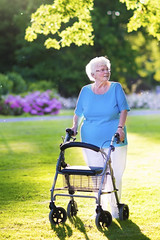 iStock_000061286578_Large (UICmedia) Tags: walker senior old walking elderly woman lady disabled people care aged patient home help female pensioner disability person frame aid mobility retirement retired health mature handicap caregiver adult caucasian park older assistance hospital smiling outdoors medicine support portrait garden happy citizen grandmother grand rollator rolling wheel chair summer together healthcare