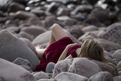waiting fot the tide (FanFan Babii or just plain Buffan) Tags: stones rock model thea red lying down waiting autumn cold tide girl youngwoman