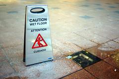 wet (Ian Muttoo) Tags: dsc77471edit toronto ontario canada gimp ufraw metrohall caution wetfloor wet floor attention cuidado street sidewalk water outdoors
