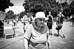_DSC4904 (stimpsonjake) Tags: nikoncoolpixa 185mm streetphotography bucharest romania city candid blackandwhite bw monochrome oldwoman hat face eyes frown
