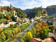 Autumn in Fribourg, Switzerland (` Toshio ') Tags: toshio fribourg freiburg switzerland river lasarine autumn fall trees valley europe european city architecture wall history iphone rooftops bridge