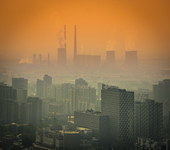 Into The Hazy Air In Beijing (Stuck in Customs) Tags: china city people orange color colour green rooftop silhouette skyline skyscraper square grey smog office haze glow cityscape zoom outdoor background smoke horizon beijing rr cbd powerplant distance foreground focuspoint billion 2015 northeastchina stuckincustoms treyratcliff stuckincustomscom may2013 sonynex7