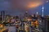 Cloudy Sunset over Kuala Lumpur City (Nur Ismail Photography) Tags: sunset sky skyline clouds asia colours sony dramatic malaysia twintowers kualalumpur klcc kltower petronastwintowers lighttrail nurismailphotography nurismail a7rii ilce7rm2