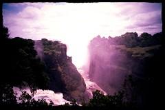 Victoria Falls or Mosi-oa-Tunya is a Waterfall in Southern Africa on the Zambezi River at the border of Zambia and Zimbabwe Indiglow Feb 8 1999 003a (photographer695) Tags: victoria falls or mosioatunya is waterfall southern africa zambezi river border zambia zimbabwe feb 8 1999