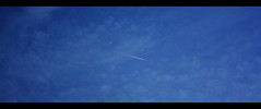 Alone in the blue III (philippe.ducloux) Tags: blue sky cloud france clouds plane canon aircraft bleu ciel filter nuage nuages avion filtre polarizingfilter polarizing sudouest hautegaronne midipyrnes polarisant 450d canon450d filtrepolarisant strictlygeotagged xpanformat