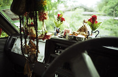 The inside of a car serves as a shrine in Chiang Mai, Thailand