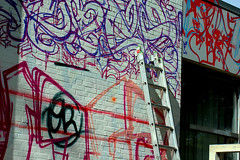 One building, one idea! ( 348th picture of the same building) - `East side !: `Five years - graffitis and our sports hall ! (tusuwe.groeber) Tags: blue red streetart colour building rot art sport project germany graffiti purple jujitsu sony violet lila lilac colourful blau gebude farbig bunt projekt oldenburg farben violett favorit sportsclub niedersachsen lowersaxony sportshall sporthalle funkyfresh jujutsu lovelycity tusbloherfelde bloherfelde sonyphotographing nex7