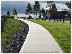 Pathway on the hill (fotograf1v2) Tags: house concrete path australia victoria woodenfence recreation curve footpath streetscape roadway pakenham streettrees publicpark grassverge eucalyptustrees watersidedrive cardiniashire postrailfence formerstonequarry cardinialakes