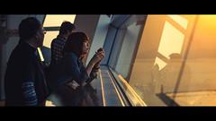 Cinematic Series #07 (Laser Kola) Tags: cinematicseries cinematographer cinematic sundown sunset beautifulsunset settingsun warm woman view laserkola lasseerkola widescreen 100mm 100m canonef100mf2 f2 canon5dmkii canon5dmarkii reflections coldandwarm coolandwarm candid unposed moody atmospheric osaka japan  kosumo tawa cosmo tower