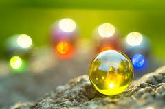 Marbles (Emil.D) Tags: marbles bokeh makrolens closeup sun bright round cirkle shiny