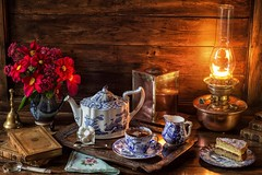 Tea by Lamp Light (memoryweaver) Tags: stilllife memoryweaver cake flowers teapot cup tea victorian artsandcrafts light lamp antique vintage copper brass kerosene paraffin oillamp lampsveritas