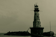 Rock of Ages Lighthouse (Daniel Ketchelos Photography) Tags: lighthouse muted black white lake superior boat island
