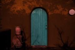 falling shadows (Eric Baggett) Tags: sonya7rii adobe shadows fall doorway newmexico turquoise orange treebranches halloweeniscoming creepy mysterious latenightphotography
