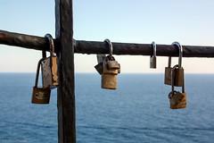 Fence with padlocks (EvelyneRenske) Tags: fence padlock padlocks sea