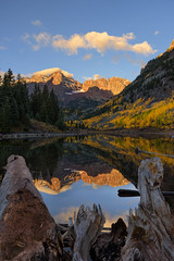 Fallen Trees (johndanielphoto) Tags: autumn trees sky sunrise lake forest mountains water reflection blue sun clouds tree fall snow green mountain woods mirror colorado autumnhues aspen deadtrees pinetrees maroonbells fallcolors aspentrees alpenglow vertical landscape dawn lines contrast serene pumpkin spooky depth