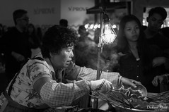 The Ajumma, ever the food expert (gunman47) Tags: 24105 24105mm ajumma asia asian b bw korea korean mono monochrome myeongdong rok republic seoul sepia south w alley black expert food lights neon night photography shopping street tourist white    southkorea