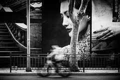 someone is always watching~ Shanghai (~mimo~) Tags: asia china fuxinglu shanghai streetphotography blur bicycle man poster wall tree hand face chinese