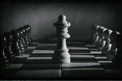 Checkered past (PommieDad) Tags: chess blackandwhite queen filmnoir pawns chessboard monochrome vintage oldschool