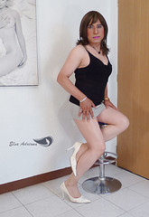 Light gray miniskirt, black sleeveless shirt, white high heels. (Elsa Adriana) Tags: elsaadriana highheels white crossdresser tgirl travesti transvestite miniskirt mature