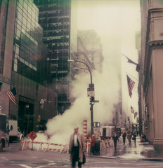 Midtown Morning (davebias) Tags: nyc polaroid sx70 flag steam tzartistic roidweek2015 autumnroidweek2015